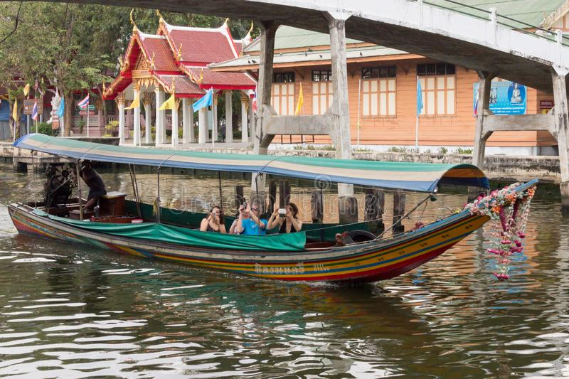 Tourists taking photographs from a boat. royalty free stock images