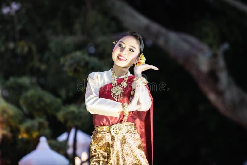 Bangkok, Thailand - March 2019: women dance traditional Thai dance in Santichaiprakan park stock photo