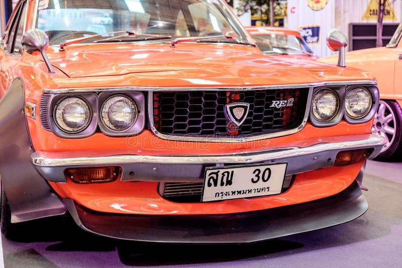BANGKOK THAILAND, - MARS 11 2018: En tappningbil Mazda RX-3: 1971-1977 visades i en klassisk motorisk show på den Seacon fyrkante arkivbilder