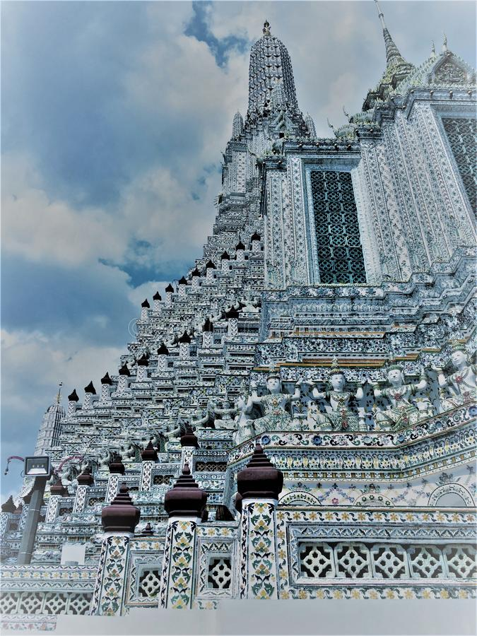Bangkok,Thailand,May 27,2019:The famous Wat Arun Ratchawararam  is a Buddhist temple wat.It is decorated by bits of porcelain . royalty free stock photo