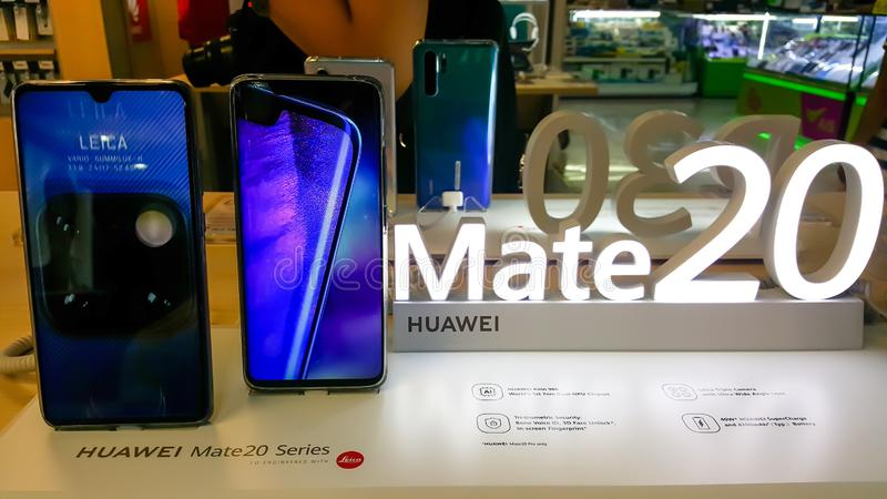 BANGKOK, THAILAND - MAY 11, 2019: Hands on Huawei Hate 20 Series that show welcome and features screen of the smartphone in retail stock photo