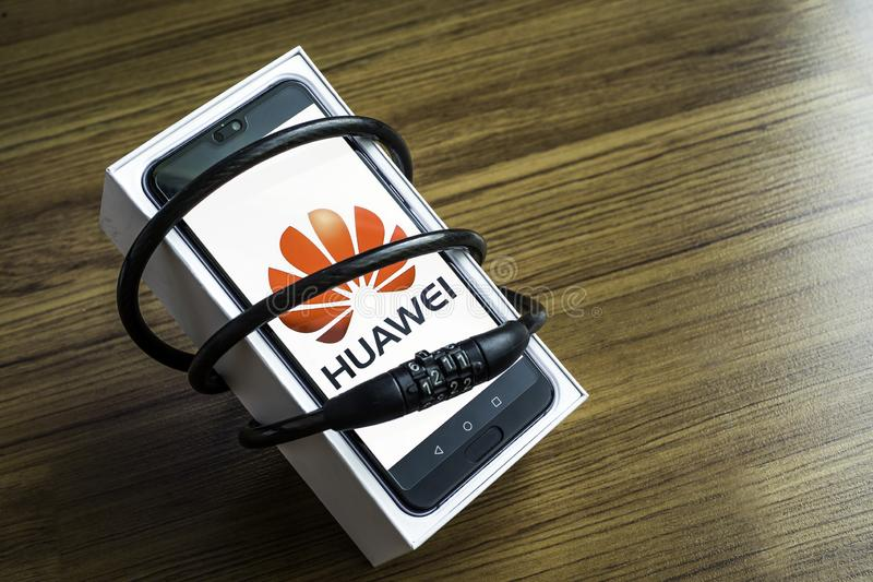 Bangkok, Thailand - May 23, 2019: Huawei phones with decoders on artificial wood flooring in the home, Huawei security issues, bus. Iness crises, Huawei logo royalty free stock images