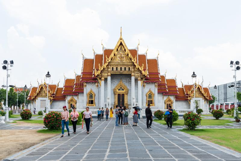 Many Tourists Visit Wat Benchamabophit,One of Bangkok most beautiful temples is the Wat Benchamabophit, stock photography