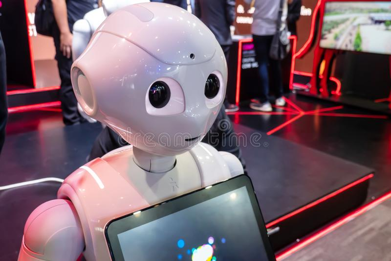`Pepper` robot assistant with digital tablet information screen in duty to give information royalty free stock images