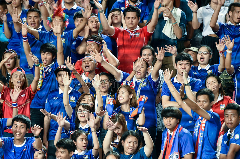 BANGKOK THAILAND NOV12: 2015 Unidentified fans of Thailand supporters during the Fifa World Cup Group F qualifying Match between stock photography
