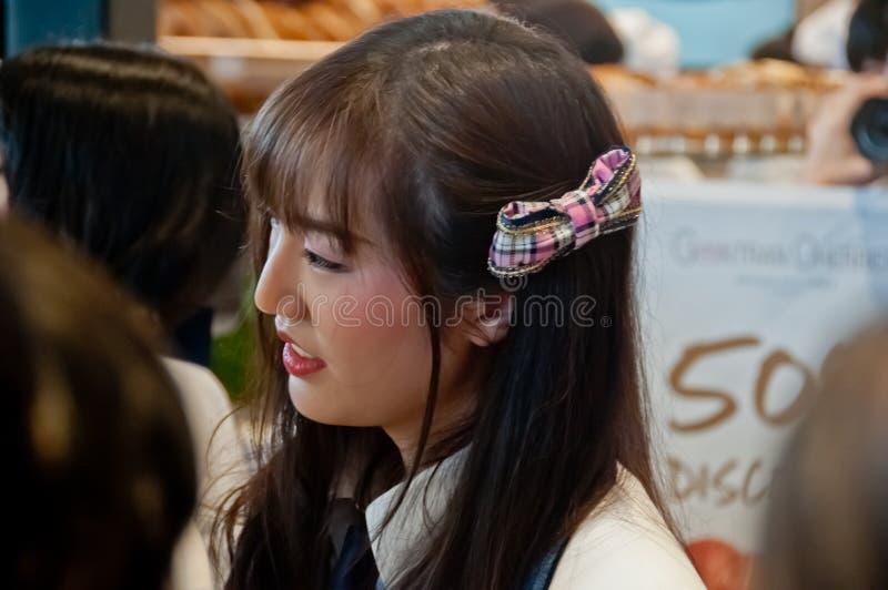 BANGKOK, THAILAND - NOVEMBER 23, 2018: Dusita Kitisarakulchai Natherine, a member of Thai Idol girl group BNK48, looks with royalty free stock images