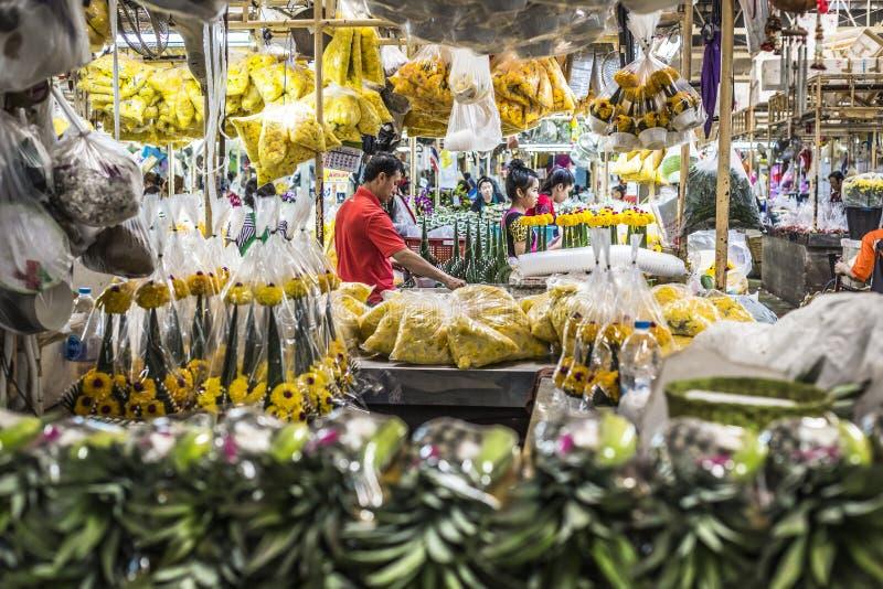 BANGKOK, THAILAND - NOVEMBER 07, 2015: Local woman sells Thai st. Yle garland (Phuang Malai) at a market near Silom road, Bangkok, Thailand royalty free stock photography