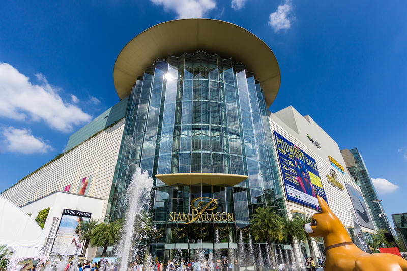 Bangkok, Thailand - 29 November 2015 : The low angle view of Siam Paragon (Luxury Shopping Mall at the Center of Bangkok). The low angle view of Siam Paragon ( stock images