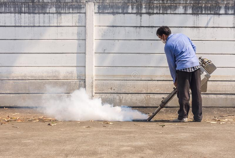 Fogging DDT spray mosquito kill for virus protect. Bangkok, Thailand - November 19, 2016 : Unidentified people fogging DDT spray for mosquito kill and protect by royalty free stock photography