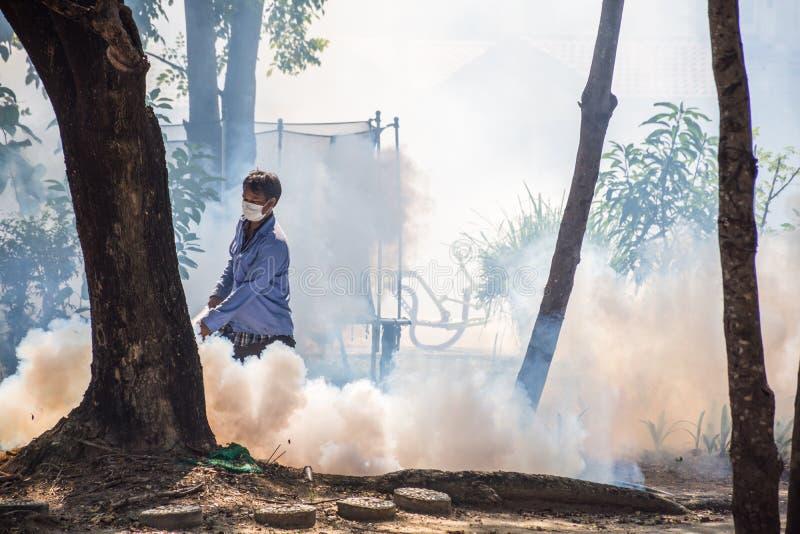 Fogging DDT spray mosquito kill for virus protect. Bangkok, Thailand - November 19, 2016 : Unidentified people fogging DDT spray for mosquito kill and protect by stock photos