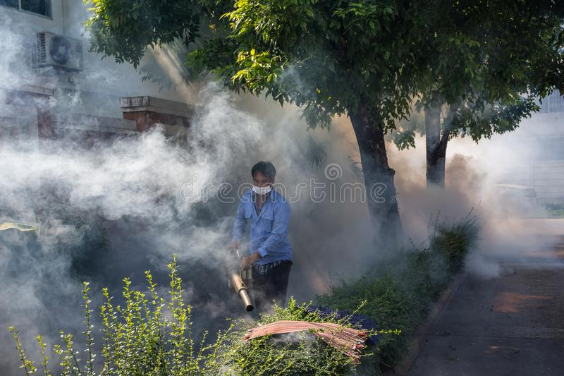 Fogging DDT spray mosquito kill for virus protect. Bangkok, Thailand - November 19, 2016 : Unidentified people fogging DDT spray for mosquito kill and protect by royalty free stock photos