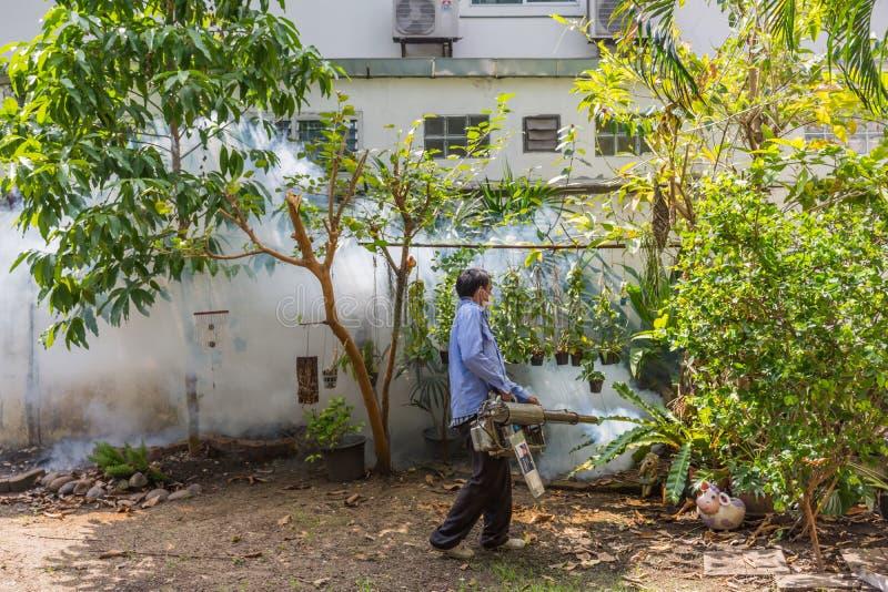 Fogging DDT spray mosquito kill for virus protect. Bangkok, Thailand - November 19, 2016 : Unidentified people fogging DDT spray for mosquito kill and protect by royalty free stock photo