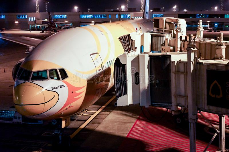 Bangkok, THAILAND - 1 Oct, 2017: NokScoot, low cost airline plane parking & waiting for passengers go to Taipei, Taiwan at night stock photography
