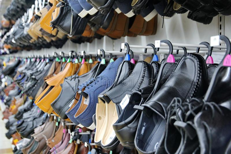 Bangkok,Thailand,14 Oct 2018 ,Several sizes of shoes were displayed on the wall in a floor show room. stock image