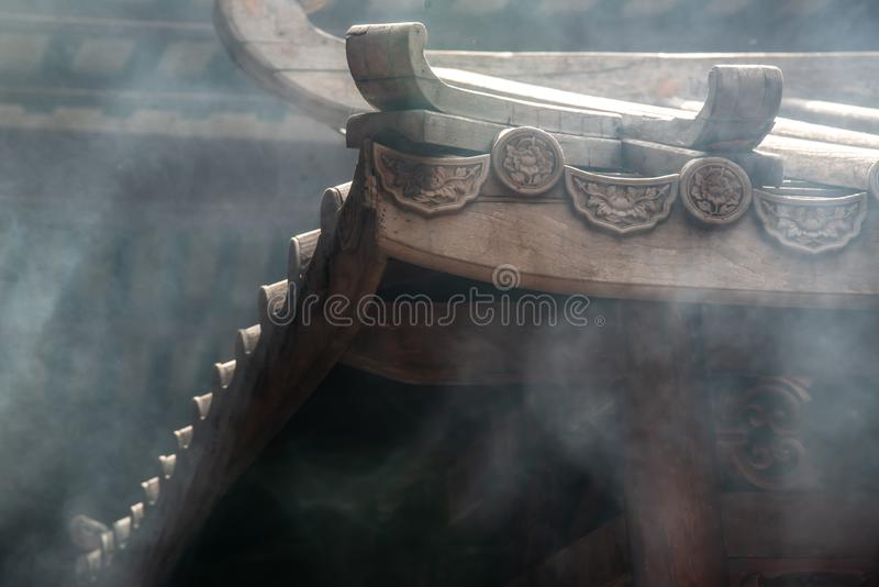 Traditional patterns of the ancient Chinese Temple roof, Within the Dragon Temple Kammalawat Wat Lengnoeiyi, Wat Leng Noei Yi is. Bangkok, Thailand - 27 Oct 2019 stock photography