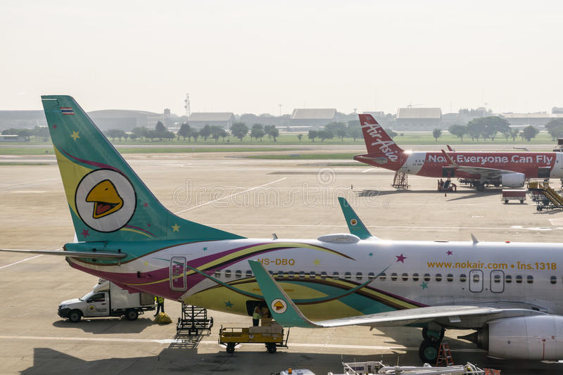 Bangkok, Thailand - 29 October 2015 : The Airplanes at the Terminal of Don Mueang Internation Airport (DMK). The Airplanes at the Terminal of Don Mueang stock images