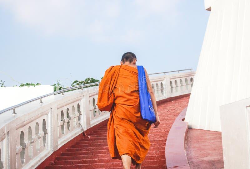 Bangkok, Thailand - October 2017: Monk climbing stairs of Wat Saket temple, also known as Golden Mount. stock image