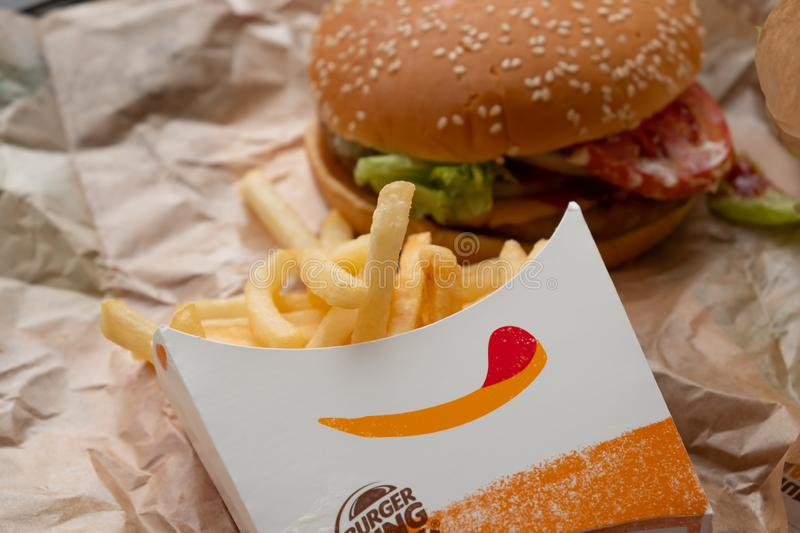 Bangkok, Thailand - October 11th, 2019 : Closed up of Burger King's french fries and burger on brown paper stock images