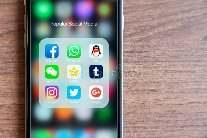 BANGKOK,THAILAND - OCTOBER 5th, 2018 : iPhone with icon of popular social media app are trendy in 2018. Facebook, Whatsapp, QQ, We stock images