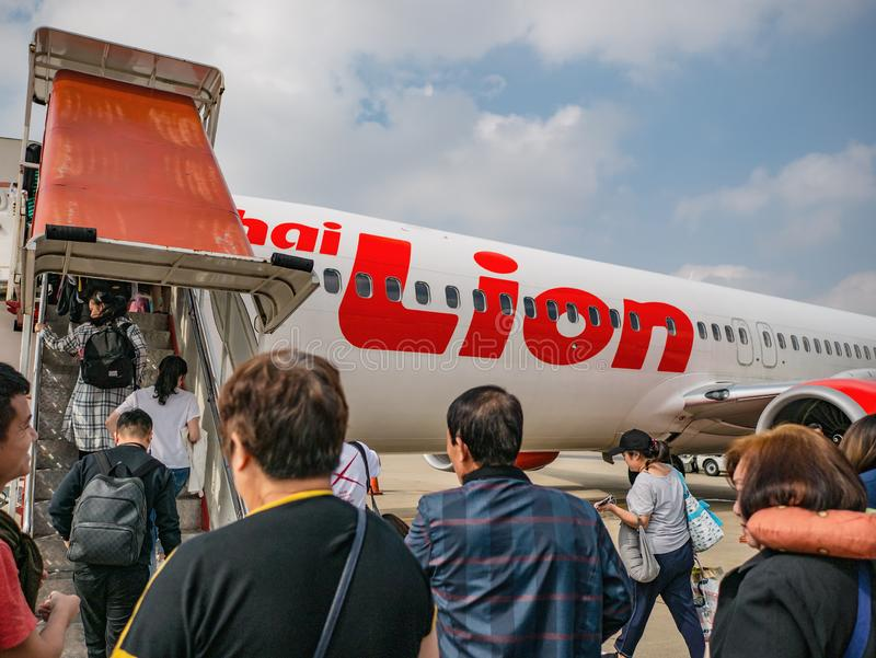 Unacquainted Thai people and tourists Travel by Thai lion airline in Don muang Internation Airport Bangkok city thailand. Bangkok/Thailand - 13 October 2018 stock image