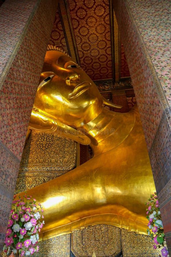 Bangkok, Thailand - July 06, 2014. Recumbent Buddha. Bangkok, Thailand - Recumbent Buddha gold stock photography