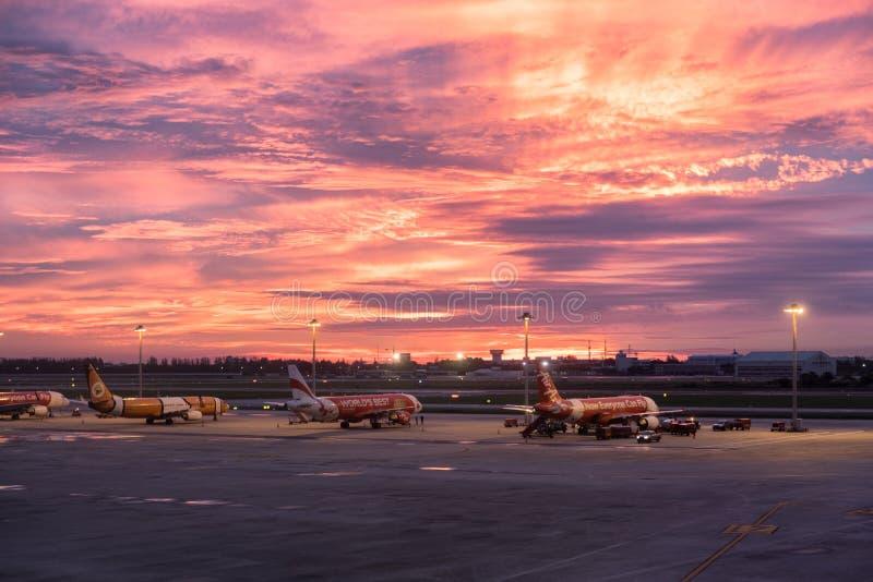 Bangkok, Thailand - Sep 06 2017 : Airplane parked in airport at beautiful sunset stock photos