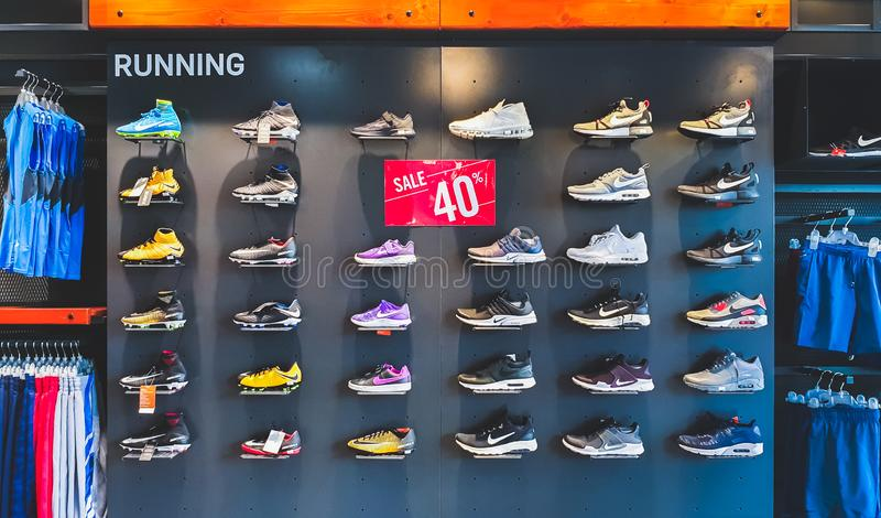 Bangkok, Thailand - Sep 11, 2018: Nike running shoes and sport clothing on 40% promotion price discount shelf at Nike outlet store stock images