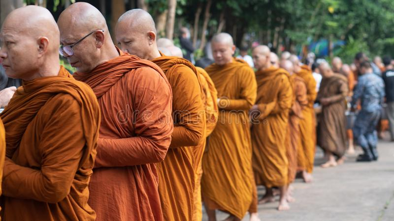 Bangkok, Thailand, September, 2019 - on buddhist holy day Thai buddhist monks walking in row to recieve food offering from stock photo