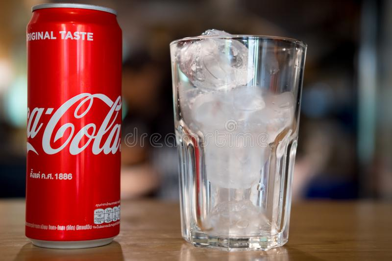 Bangkok, Thailand - September 22, 2019: Can of Coca-Cola and ice in glass stock photography