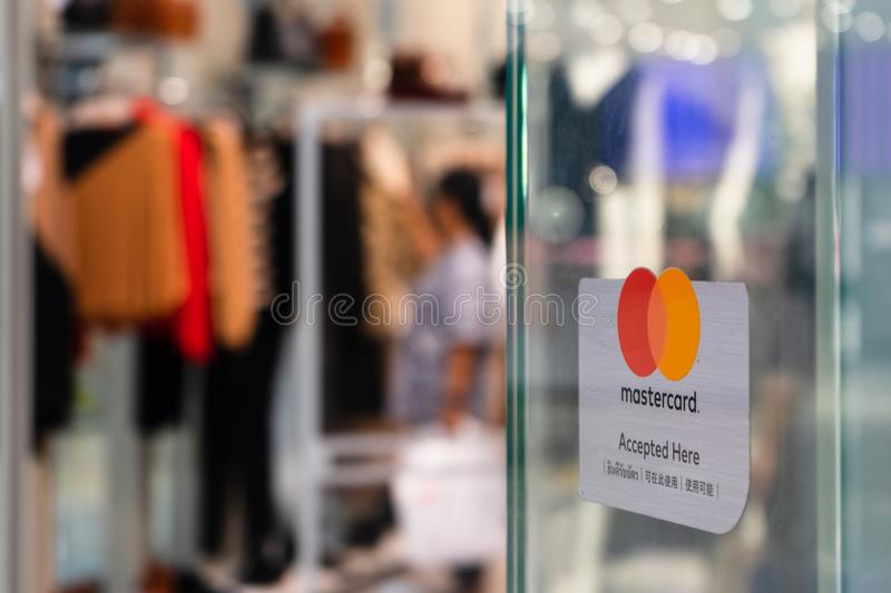 Bangkok, Thailand - September 22, 2019: Mastercard accepted and welcome sign in front of a clothing shopping store in in Bangkok, royalty free stock image