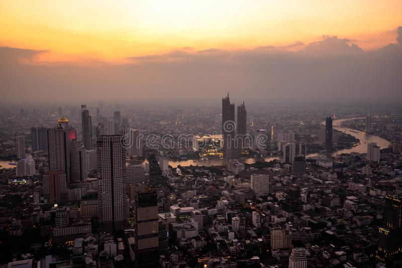 Bangkok, Thailand - September 27 2019: Panoramic view of the Bangkok city Located at the top of King Power Mahanakhon Building. With The sky and sun at sunrise stock image