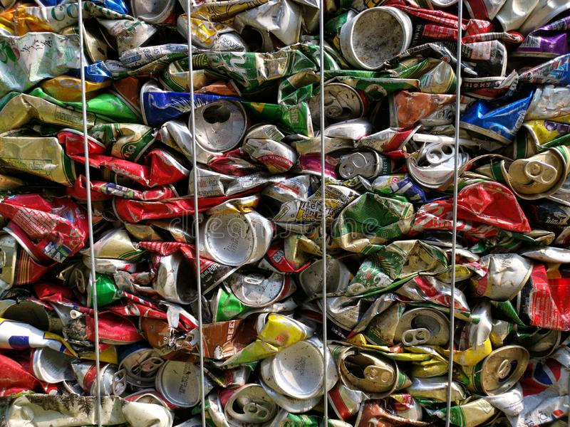 Bangkok, Thailand - September 20, 2018 : pile of old aluminum beverage cans prepare for recycle. Environment recycling metal aluminium tin reuse pressed royalty free stock photo