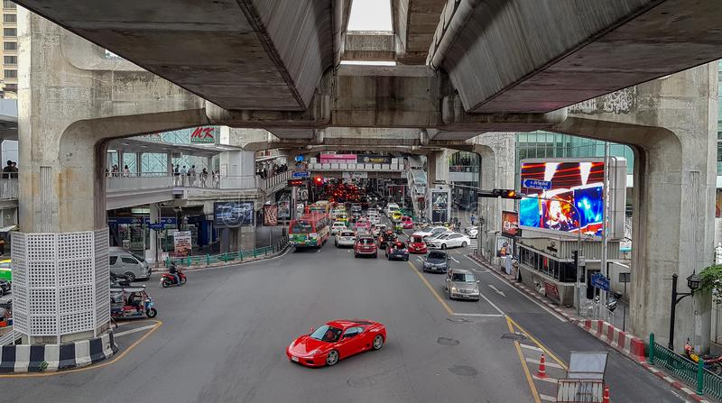 Bangkok, Thailand - September 16, 2018, a red car is solo turning at Chalerm Phao junction near Siam Paragon royalty free stock photo