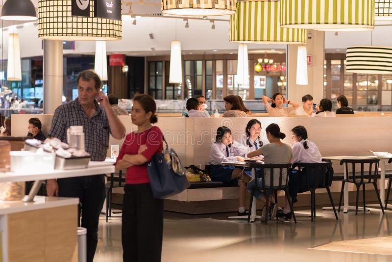 Bangkok, Thailand: Thai school girls at IKEA restaurant in Mega Bangna Shopping Mall. royalty free stock photo