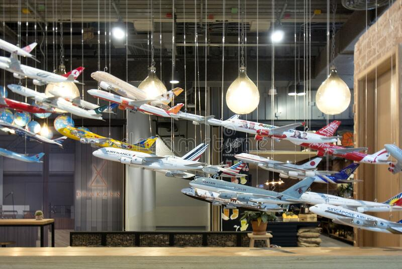 BANGKOK, THAILAND - September 16, 2017 : Variety brand airway of plane model hang for decorate in coffee shop at community mall. BANGKOK, THAILAND - September royalty free stock images
