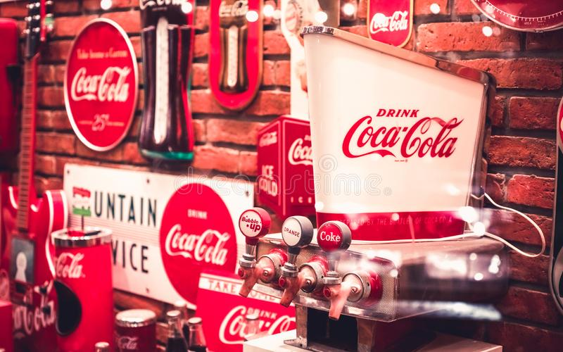 Bangkok Thailand - September 27, 2019 : Vintage retro red cocacola dispenser machine and vintage retro coke signs at coke museum royalty free stock photography
