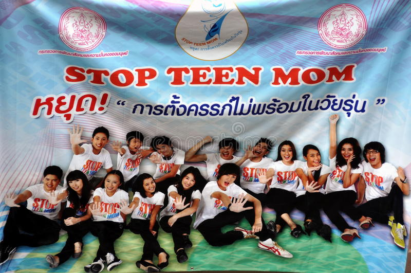 Bangkok, Thailand: Sign for Teenagers. A large advertising banner promoting teenage abstinence from sex hangs on a wall along Sukhamvit Road in Bangkok, Thailand royalty free stock image