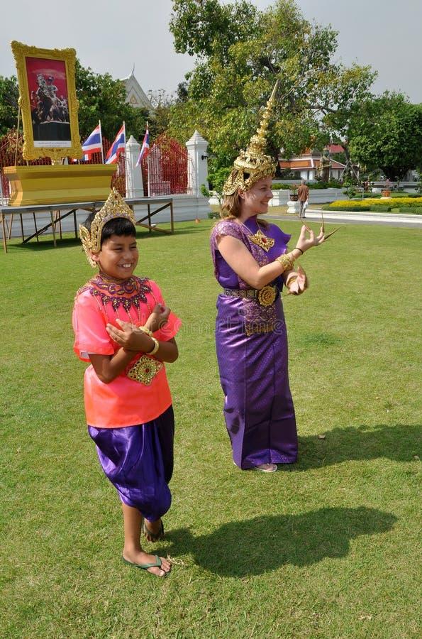 Bangkok, Thailand: Tourists In Thai Costumes Editorial Stock Photo
