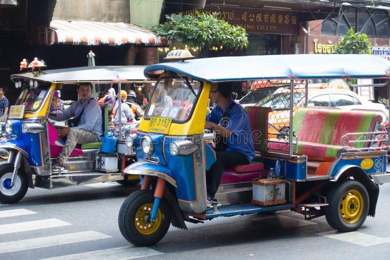 Tuk Tuk in Bangkok. Bangkok, Thailand 19/01/2019 Tuk Tuk drivers are talking during drive on the road in Bangkok royalty free stock photography