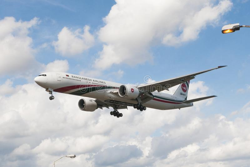 Bangladesh ailines Boeing lands at Heathrow Airport. London, Uk - August 03, 2013 - Bangladesh ailines Boeing 777 lands at Heathrow Airport royalty free stock photo