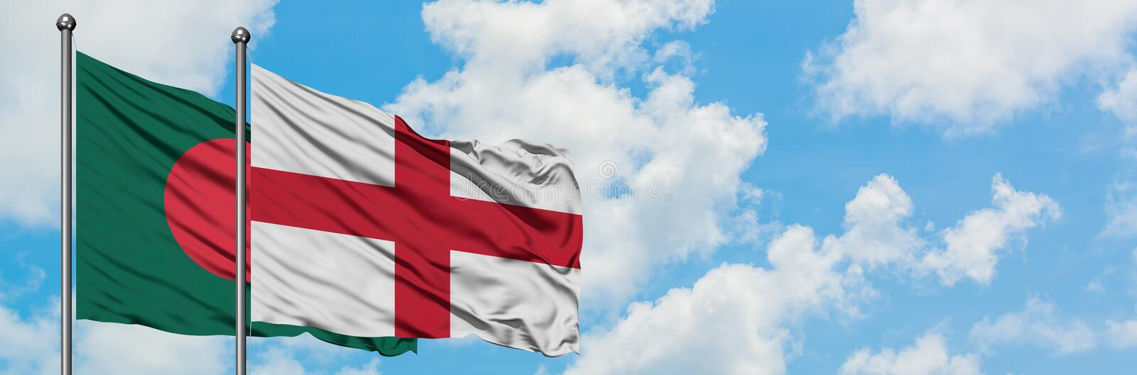 Bangladesh and England flag waving in the wind against white cloudy blue sky together. Diplomacy concept, international relations. Consul, diplomat, ambassador stock image