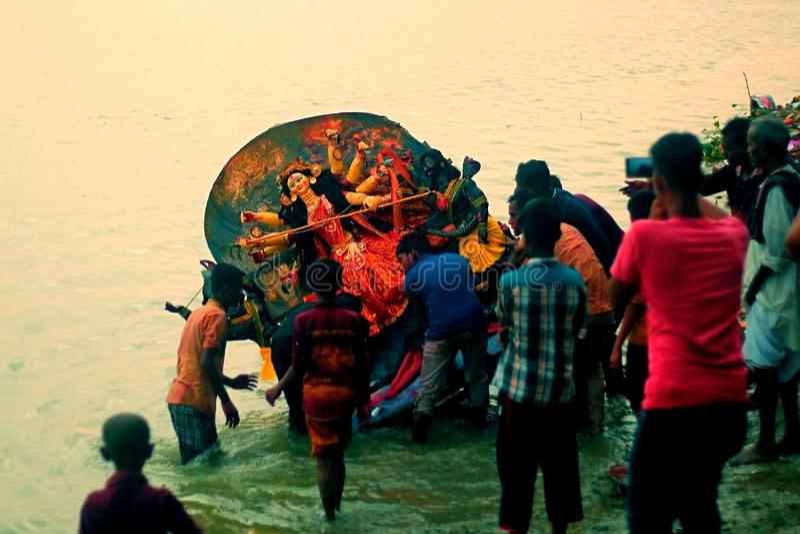 Bangladesh rajshahi, 8 october 2019. durga puja vijay dashami in bangladesh. Sunmerging the idol intothe ganges river stock photography