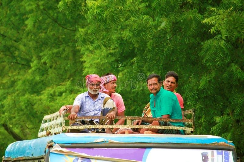 Bangladesh rajshahi, 8 october 2019. poor village people travelling at thr roof og a bus to save money. Travel banglsdesh stock image