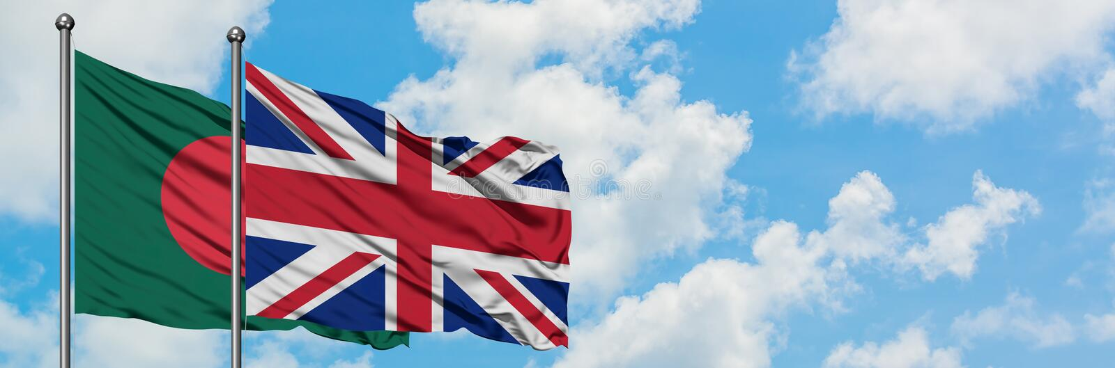 Bangladesh and United Kingdom flag waving in the wind against white cloudy blue sky together. Diplomacy concept, international. Relations, consul, diplomat royalty free stock image