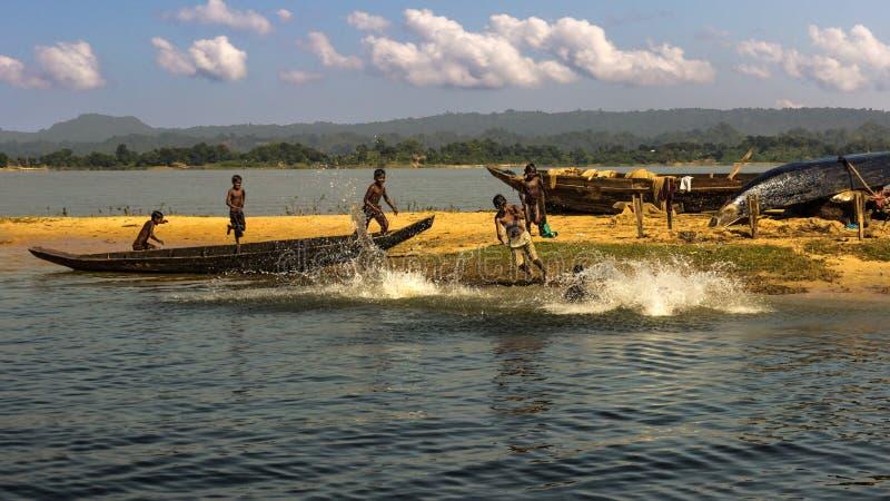 Bangladeshi childs are playing in an island inside Kaptai Lake in Bangladesh royalty free stock image