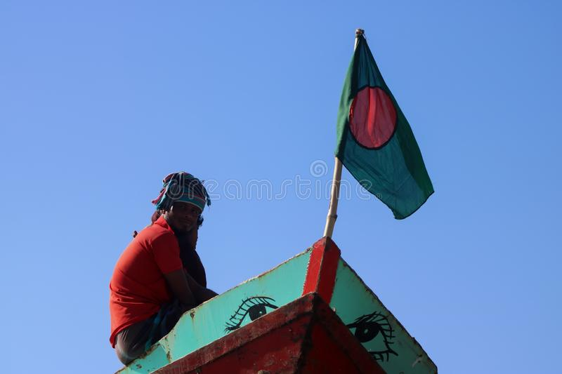 This a Bangladeshi flag in the boat stock photography