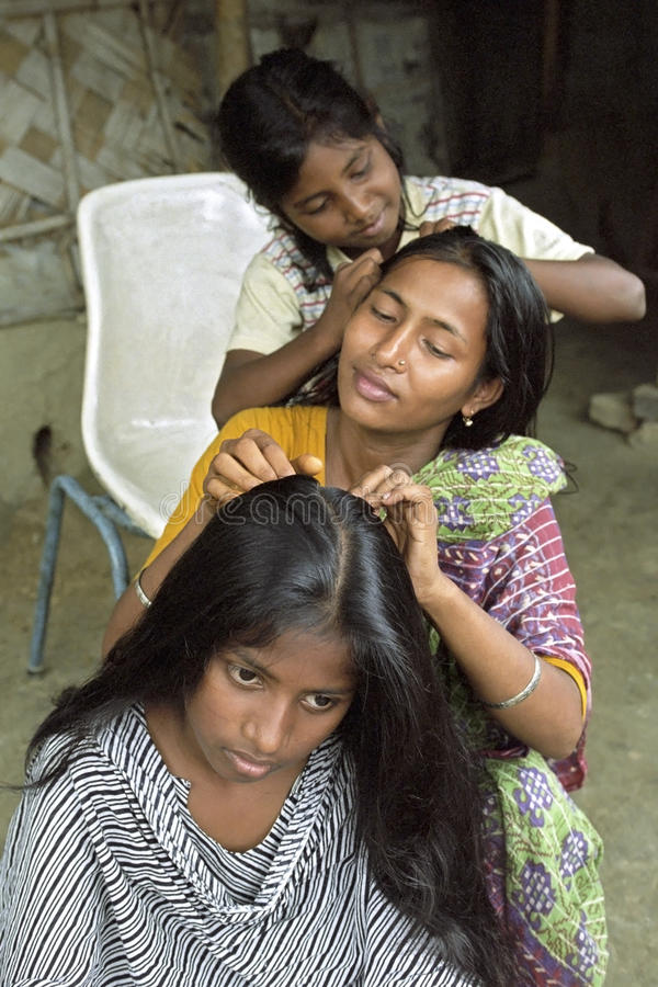 Bangladeshi teens order jointly their hair royalty free stock photography