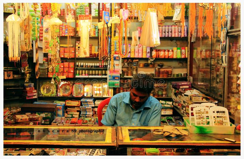 Bangle shop men serious working stock photos