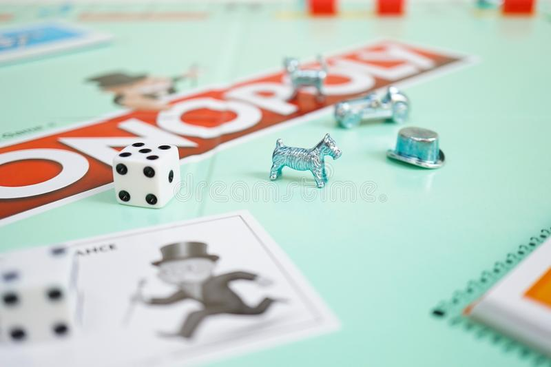 Bangkok, Thailand - Feb 11, 2019 : A monopoly board game with selective focus on the dog player. West Highland White Terrier dog. Breed. Monopoly is a famous royalty free stock image