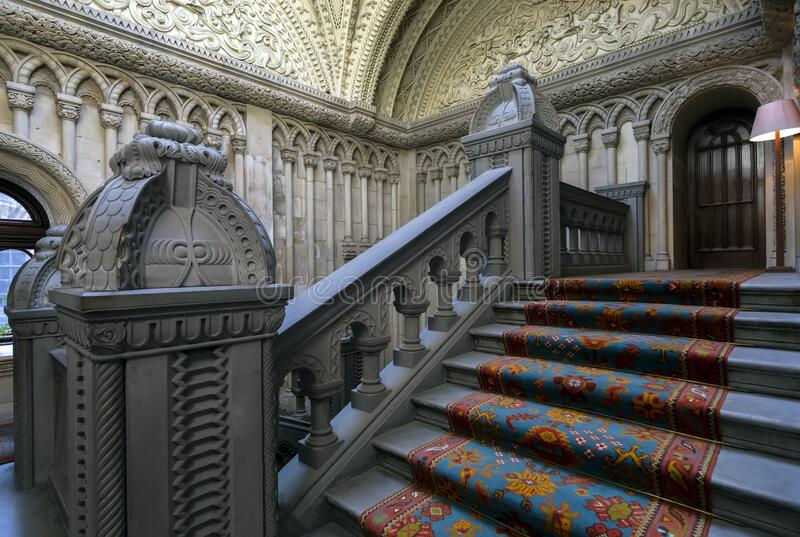 Bangor, Wales, United Kingdom - August 17, 2019, Penrhyn Castle interiors with stairway.  royalty free stock photos